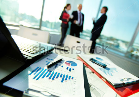 stock-photo-image-of-business-documents-on-workplace-with-three-partners-interacting-on-background-88492132